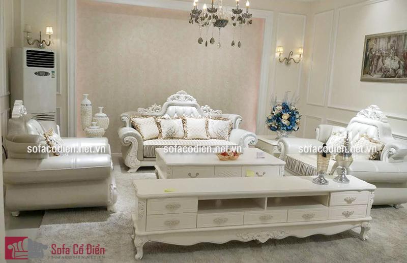Mẫu bàn trà sofa gỗ mặt kính được thiết kế theo phong cách cổ điển Châu Âu sang trọng, quý phái phù hợp với nhà biệt thự